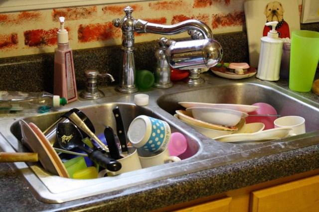 A messy kitchen sink
